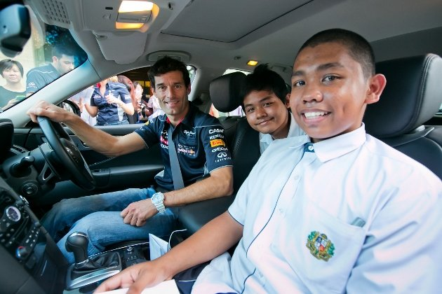 Webber-giving-joyrides-to-winners-of-helmet-design-contest-of-Assumption-Pathway-630x420
